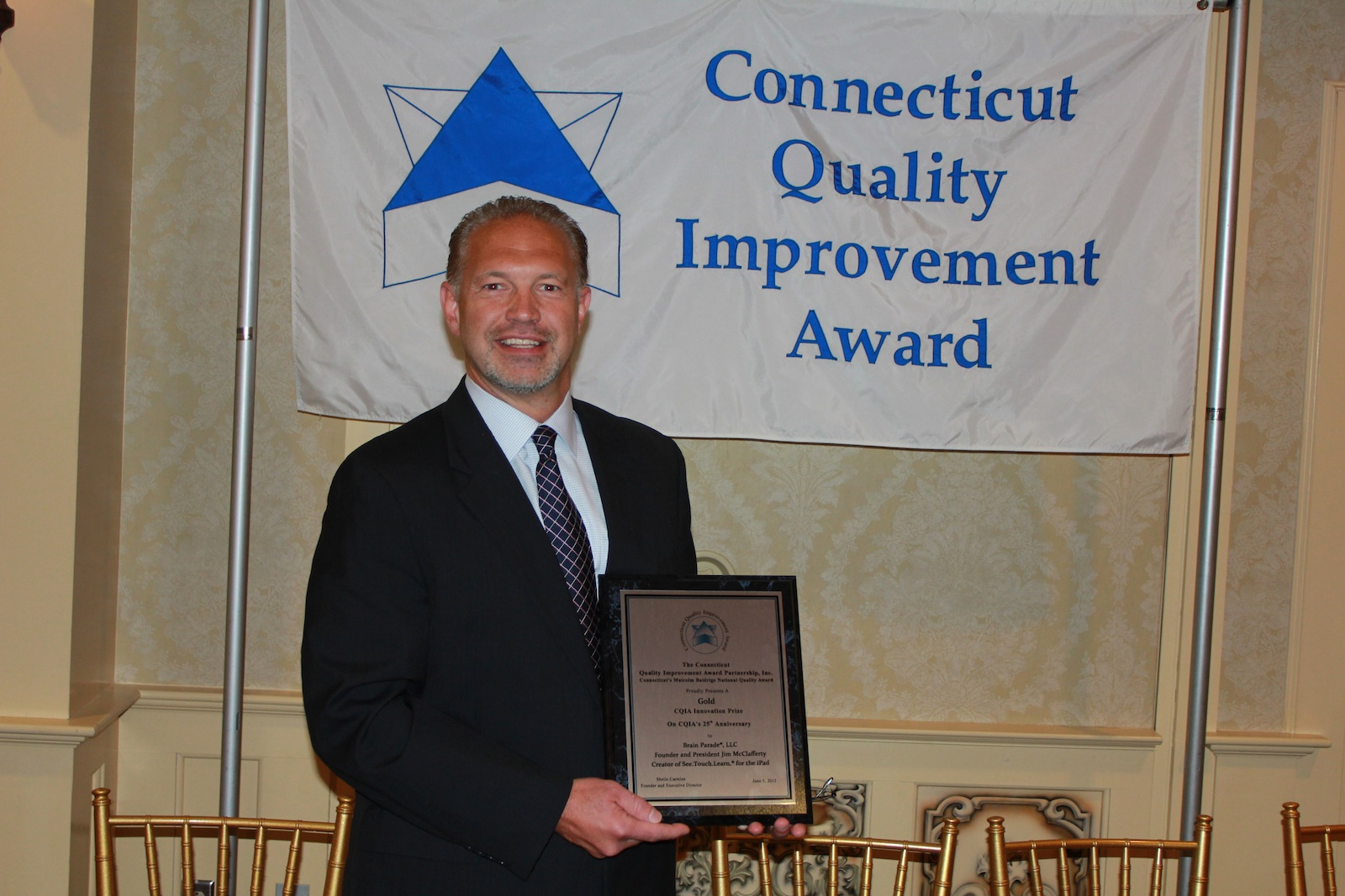 Brain Parade Founder Jim McClafferty receives the CQIA GOLD Innovation Award