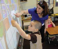 bancroft student uses SMART board